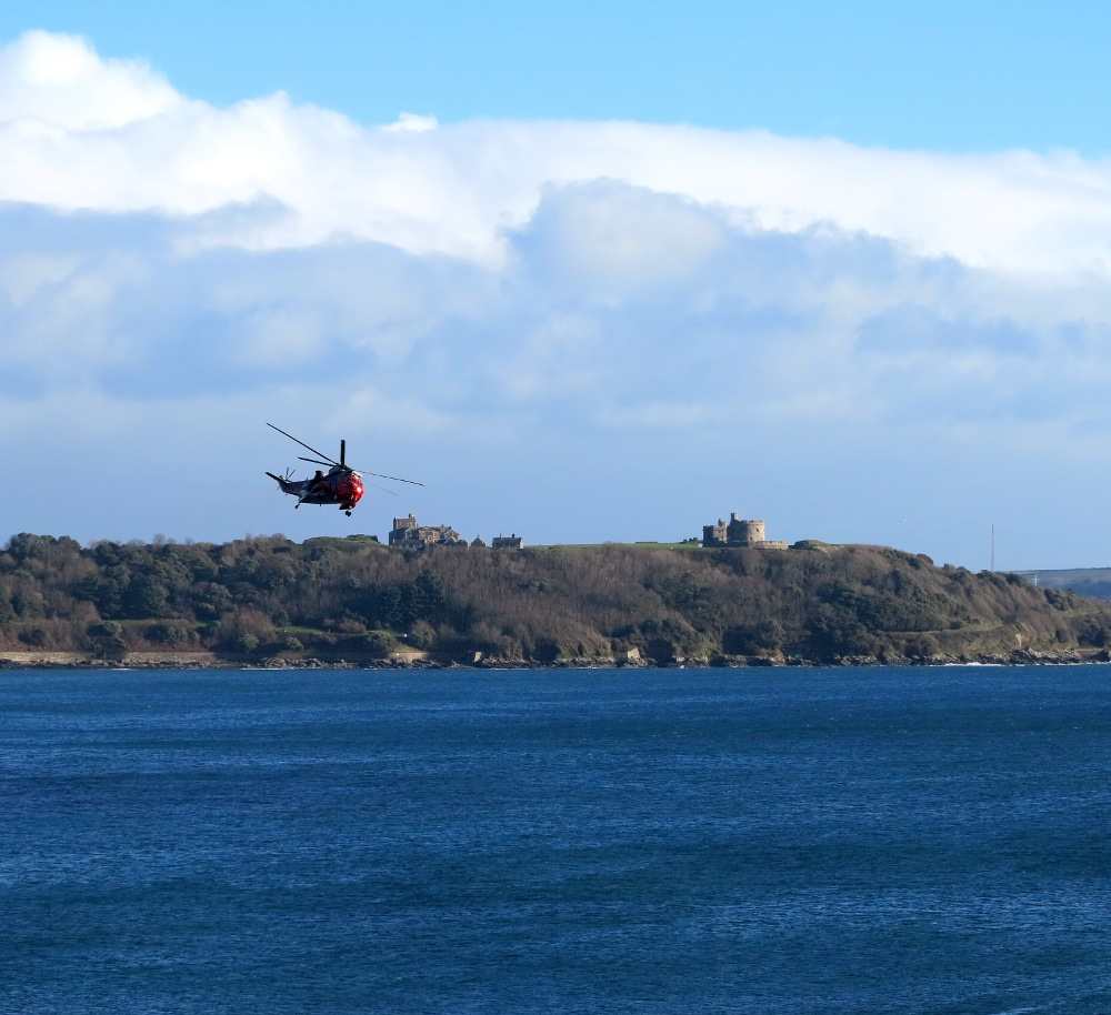 Sea King banking over Falmouth and Pendennis Castle
