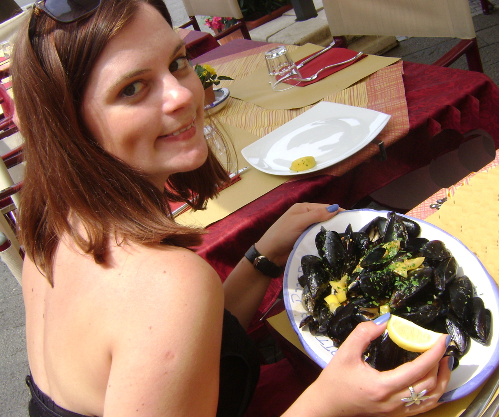 carmen eating mussels in Italy DOuble- Barrelled Travel
