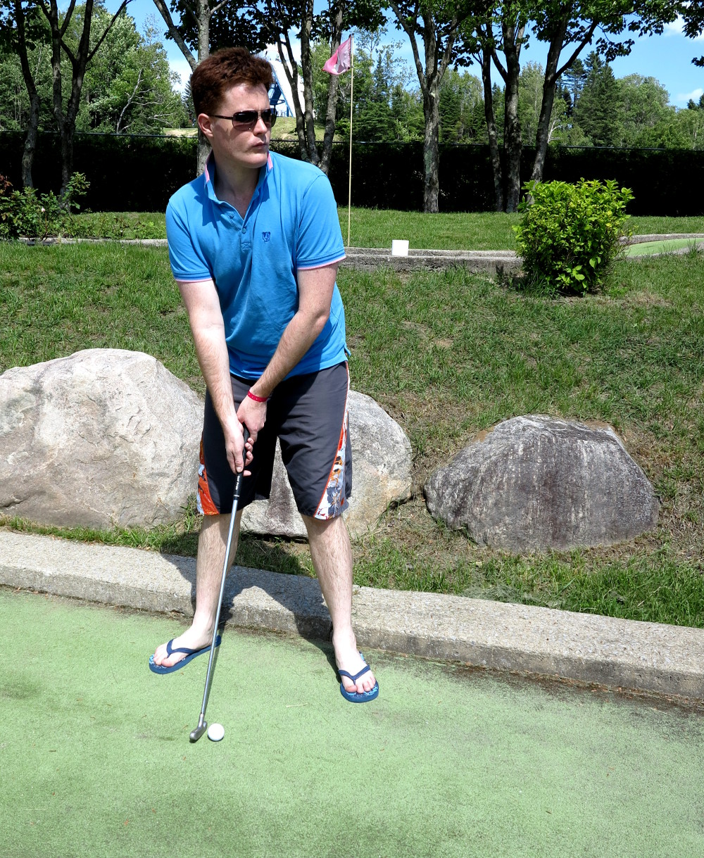 Dave playing mini golf at Village Vacances Valcartier Double-Barrelled Travel