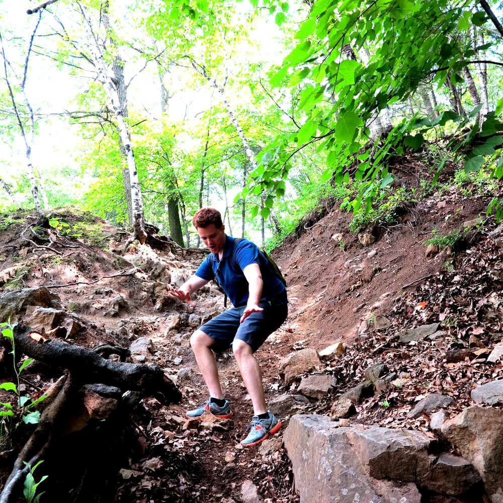 Dave scrambling down Mont Royal in Montreal Double-Barrelled Travel
