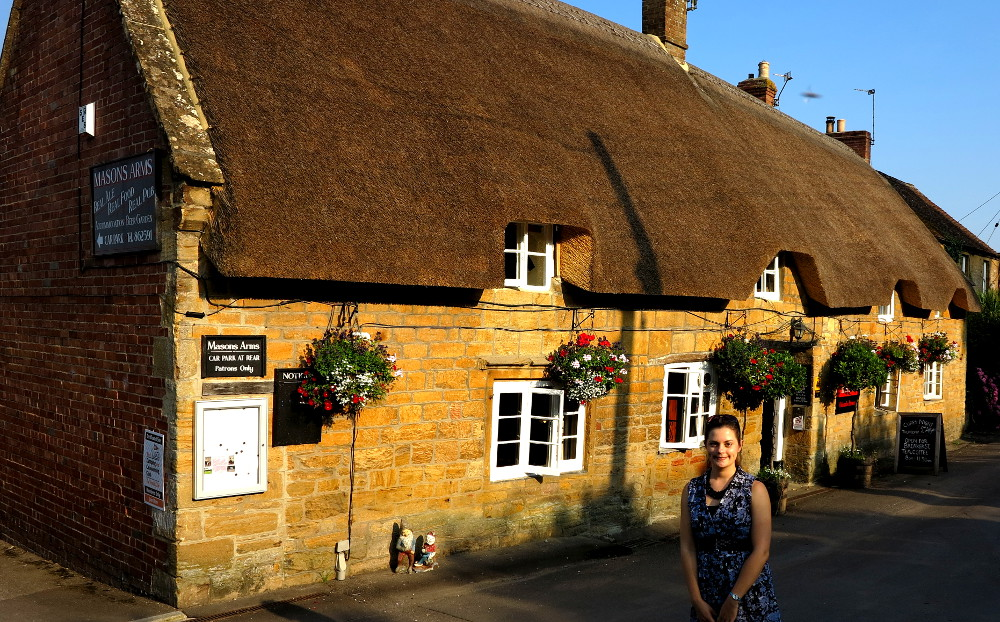 Picturesque English village thatched roof Double-Barrelled Travel