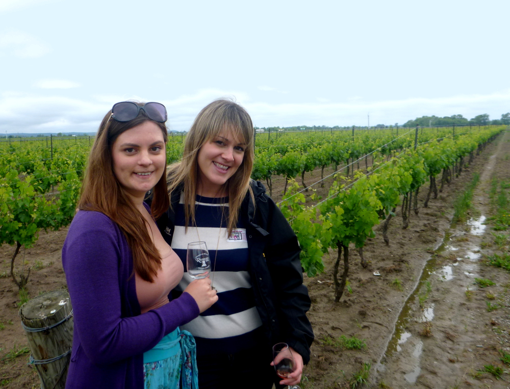 carmen and Dianna in a vineyard in niagara-on-the-lake DOuble-barrelled travel