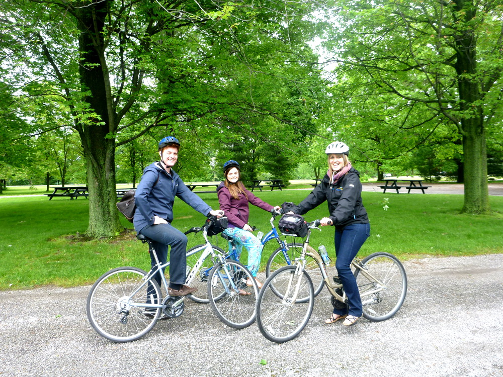 carmen dave and dianna on their bikes for the biking tour with grape escape niagara-on-the-lake DOuble-barrelled travel