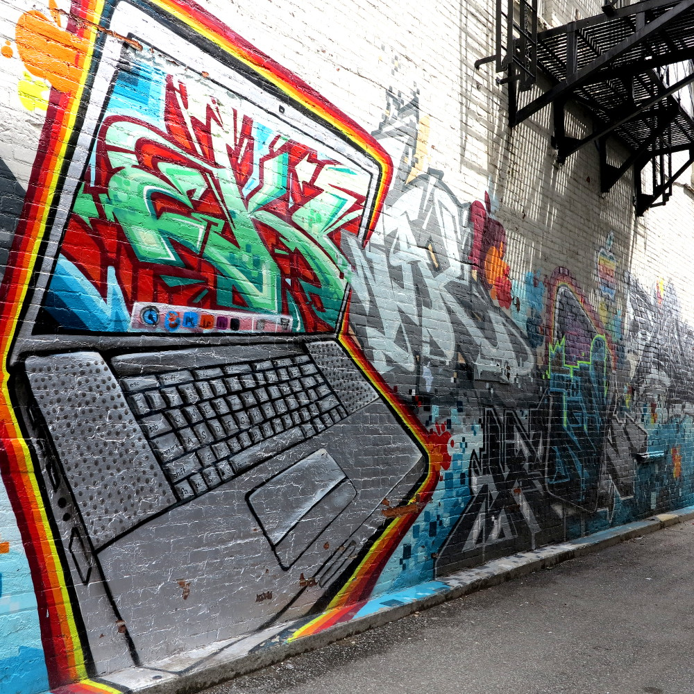 computer lap top graffiti in Kensington Market Double-Barrelled Travel