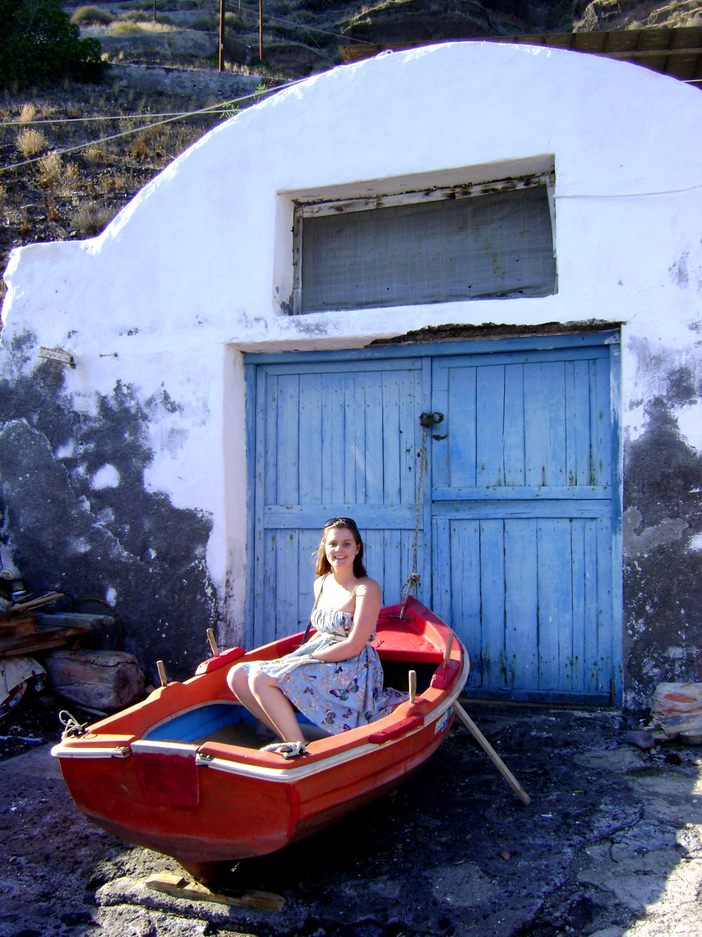 in a boat on Santorini double Barrelled Travel