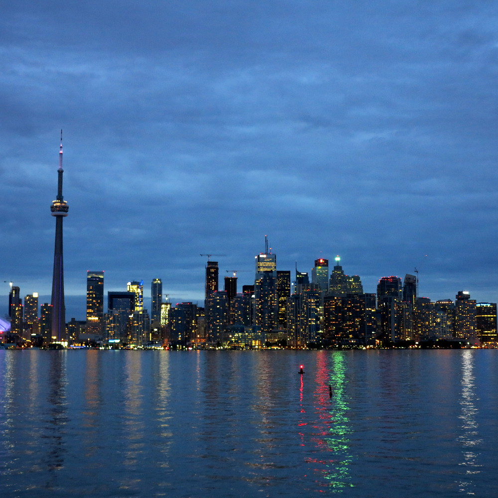 Toronto's skyline reflects far out onto Lake Ontario