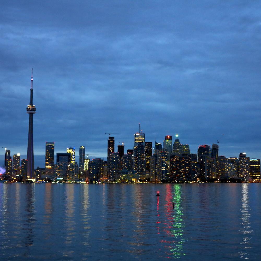 Toronto's skyline reflects far out onto Lake Ontario
