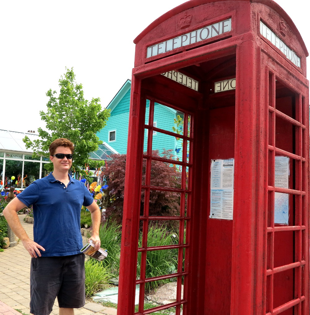 Dave standing near a British phone box in Michigan Double-Barrelled Travel
