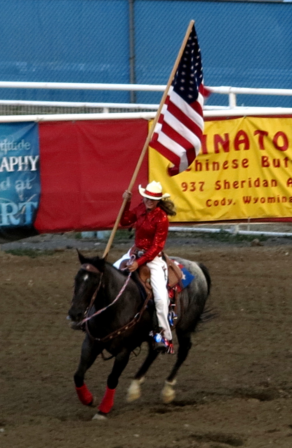 Flying the American flag on horseback at Cody rodeo Double-Barrelled Travel