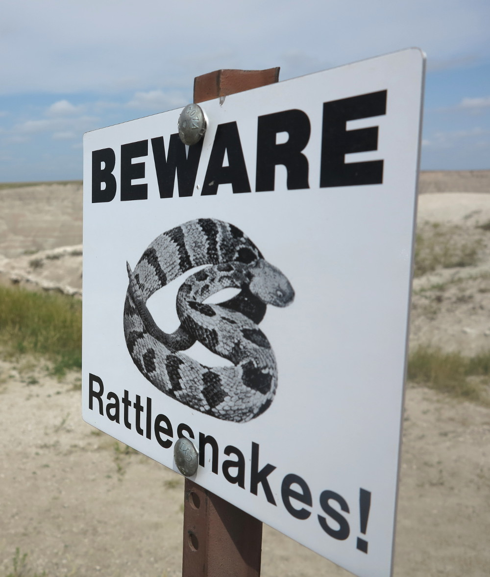 Rattlesnakes sign in the Badlands Double-Barrelledtravel