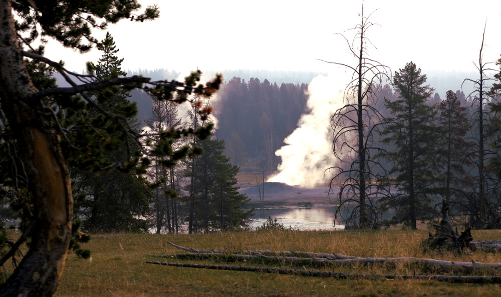 Steam from the geysers in Yellowstone Double-Barrelled Travel