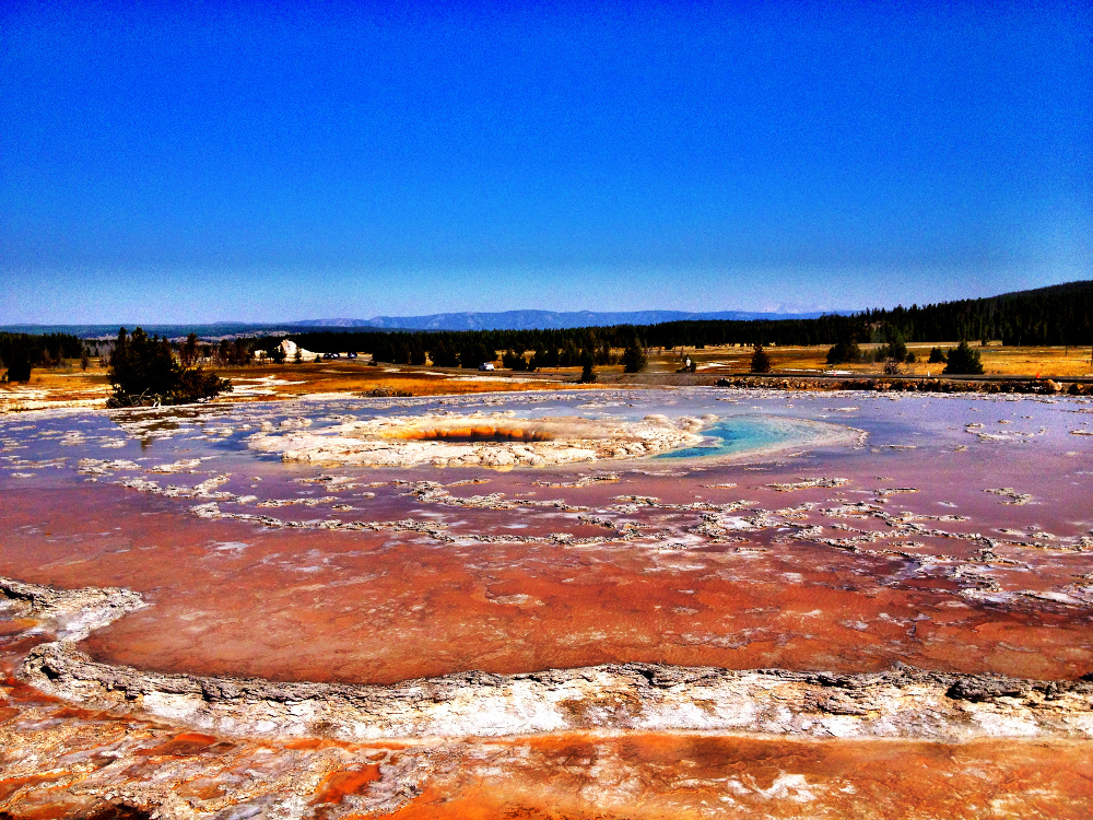 geyser near the artist's paintpots at Yellowstone Double-Barrelled Travel