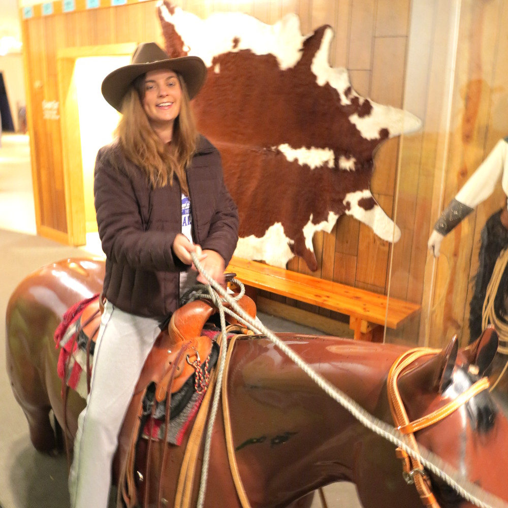 Carmen being a cowgirl at the Buffalo Bill museum Double-Barrelled Travel