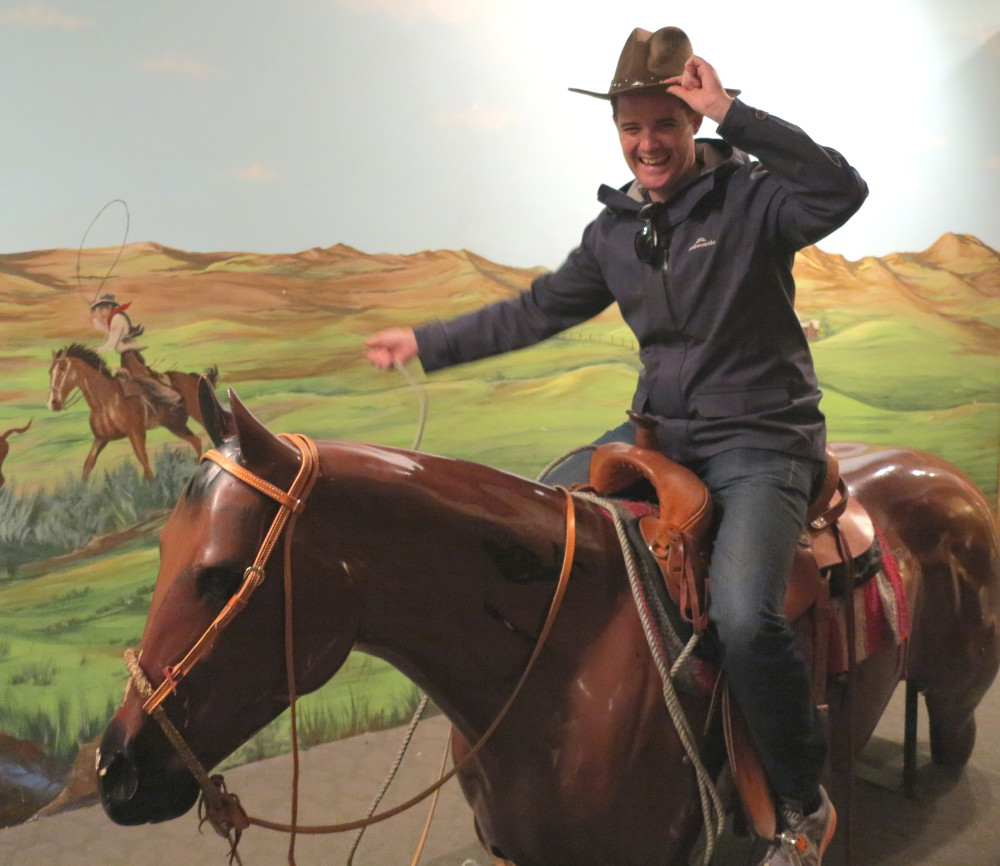 Dave being a cowboy at the Buffalo Bill museum Double-Barrelled Travel