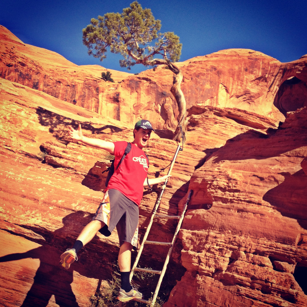 Dave hiking to Corona Arch in Utah on ladder Double-Barrelled Travel