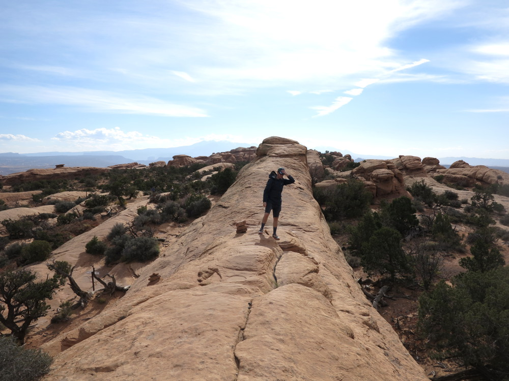 Hiking along a ridge in Arches National Park Double-Barrelled Travel