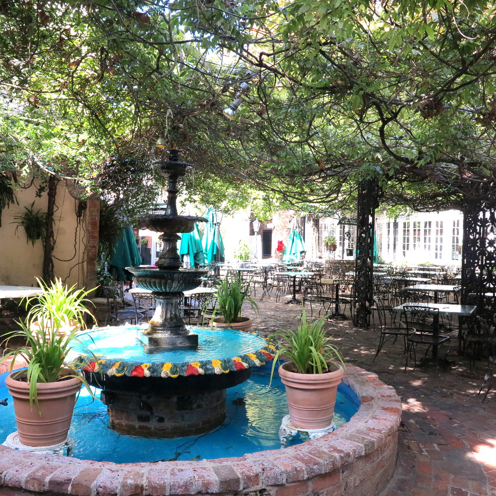 The Courtyard at The Court of Two Sisters Double-Barrelled Travel