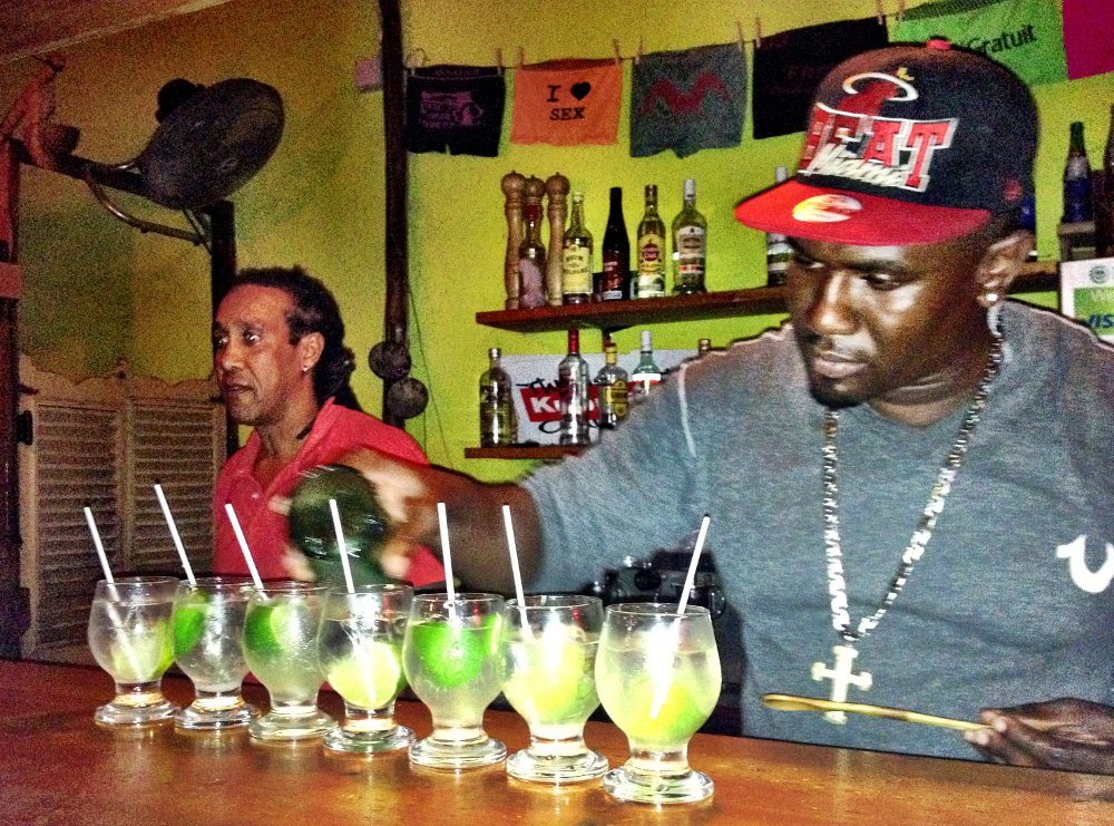 Drinking rum in Dominica Double-Barrelled Travel