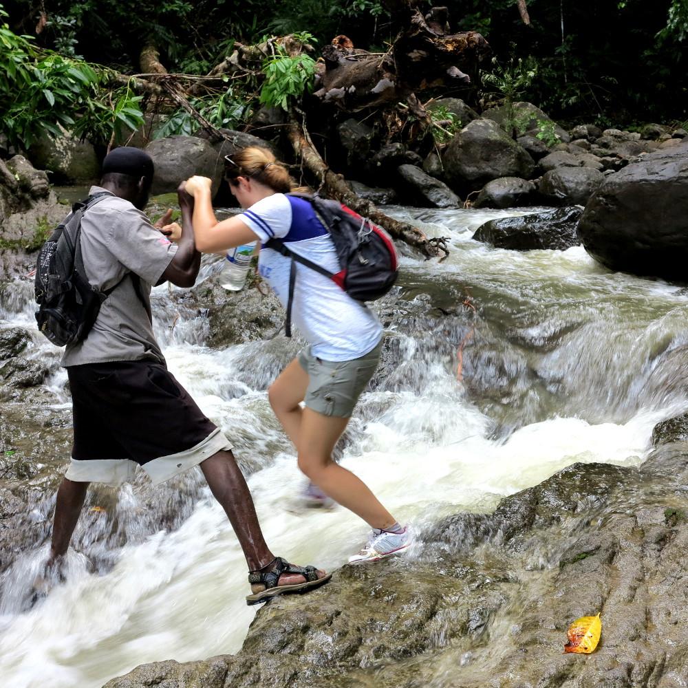 Scrambling across rocks Dominica Double-Barrelled Travel