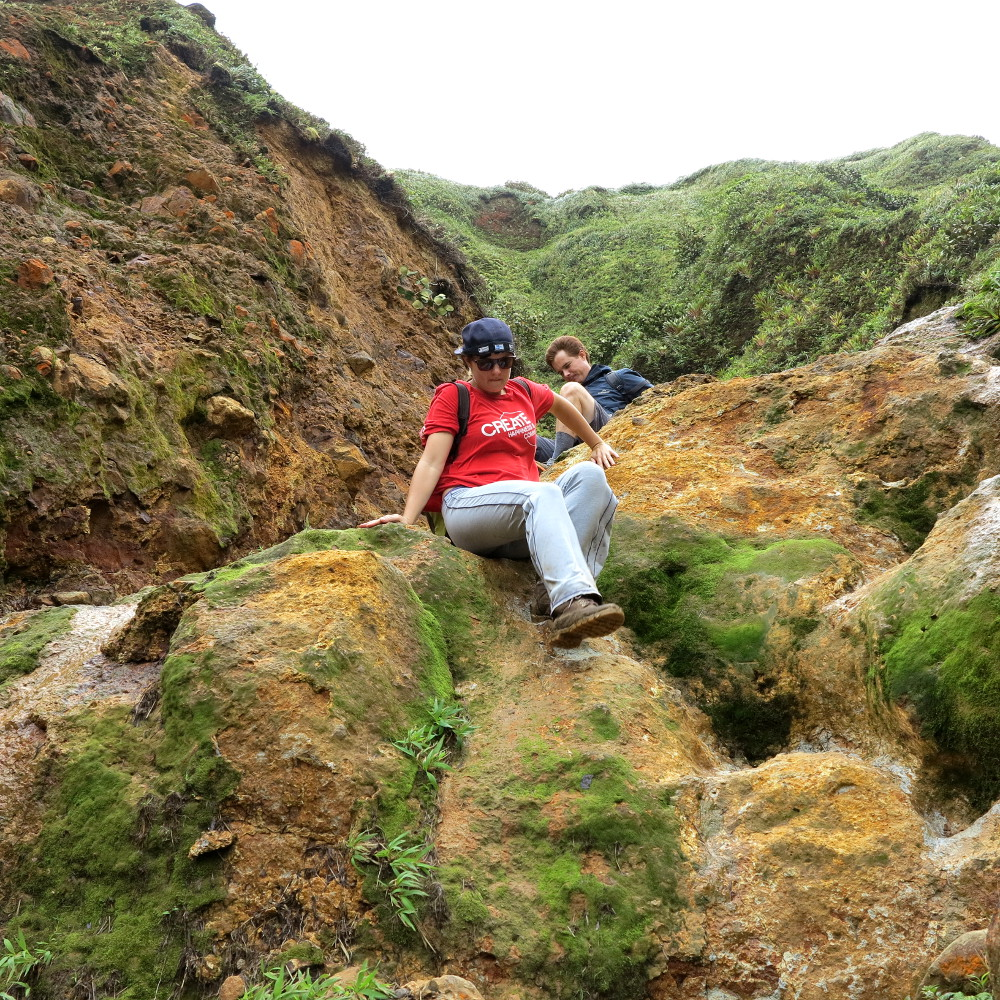 Scrambling down rocks Boiling Lake Dominica Double-Barrelled Travel
