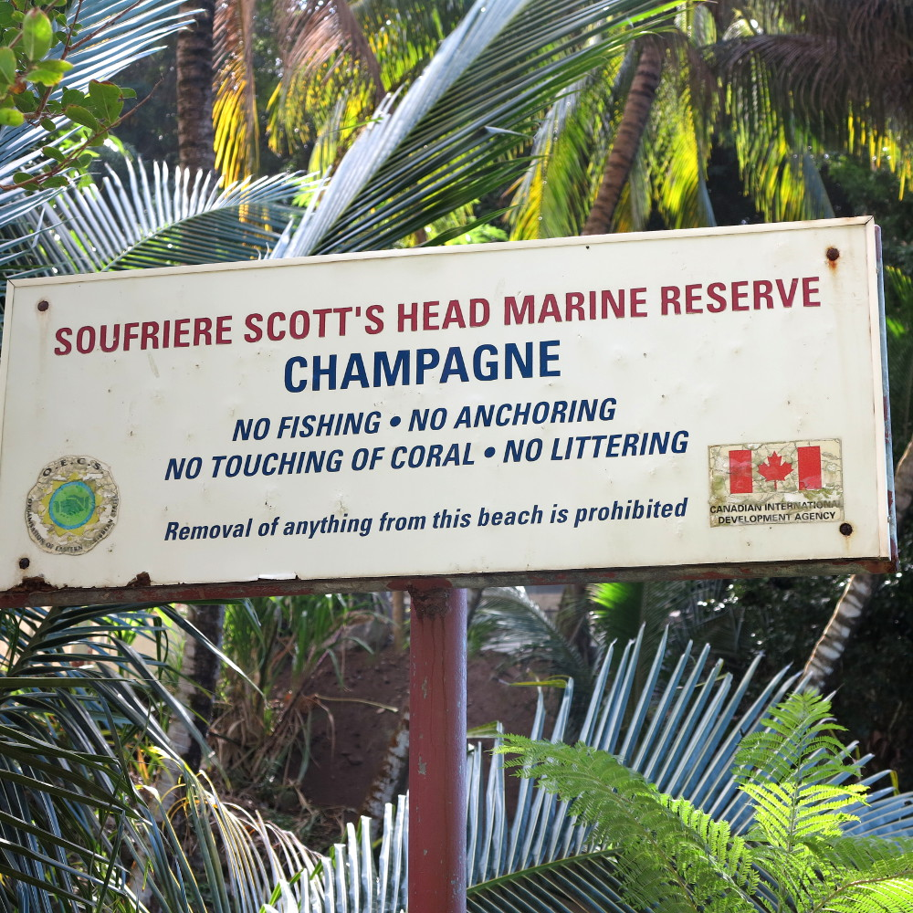 Sign at Champagne Reef Dominica Double-Barrelled Travel