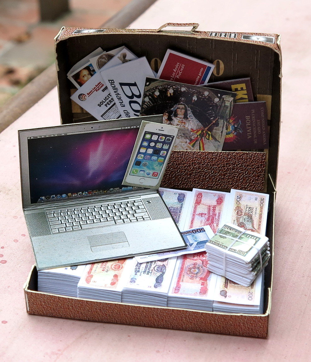 Suitcase of money and laptop La Paz Bolivia Double-Barrelled Travel
