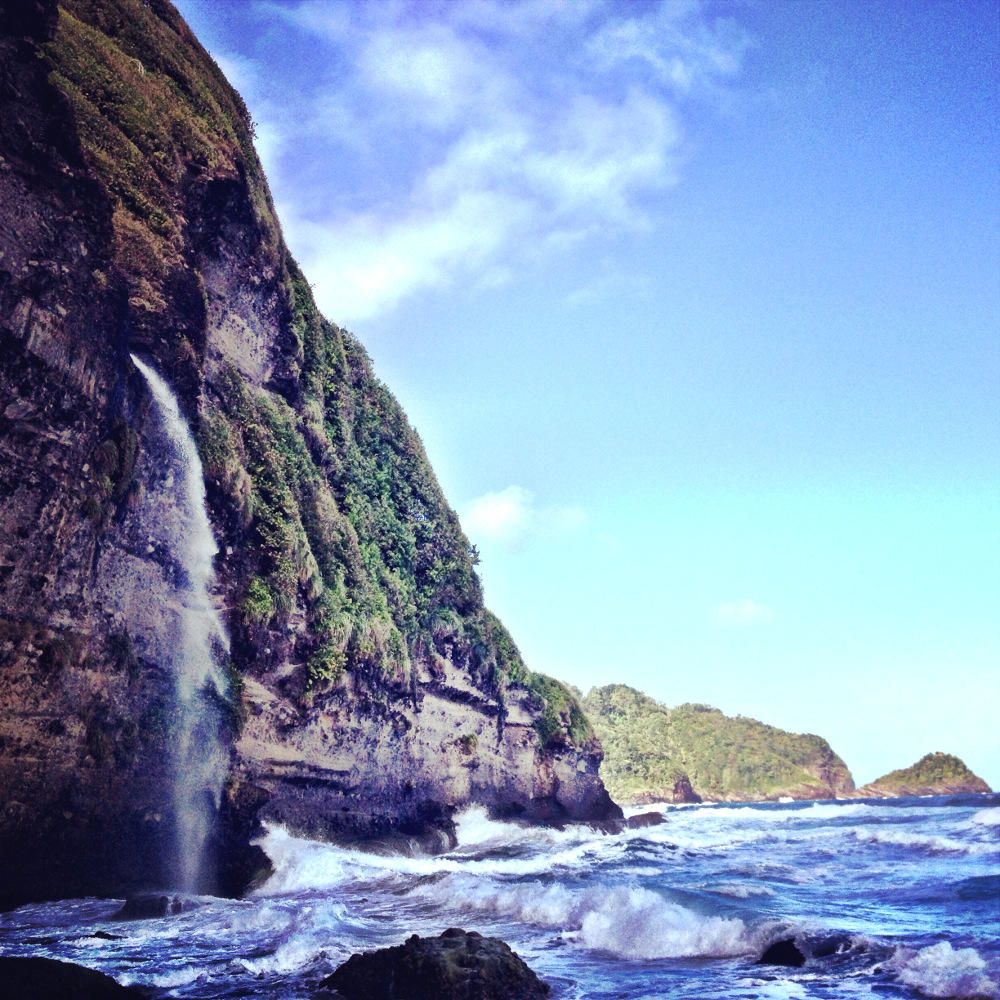Waterfall into sea Wavine Cyrique Dominica Double-Barrelled Travel