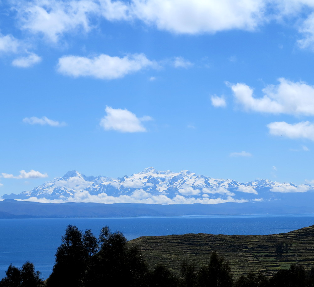 View of snow capped mountains from Isla del Sol Double Barrelled Travel