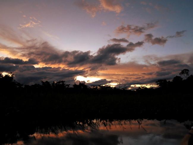 Ecuador Amazon lake sunset Double-Barrelled travel