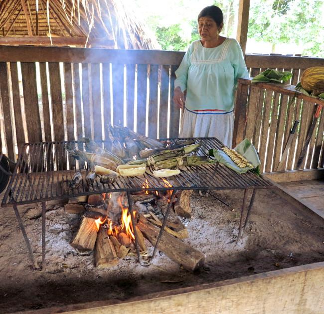 Quechua woman cooking fire Amazon