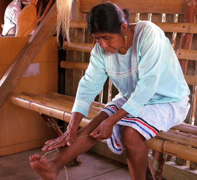 Quechua woman makes handicrafts