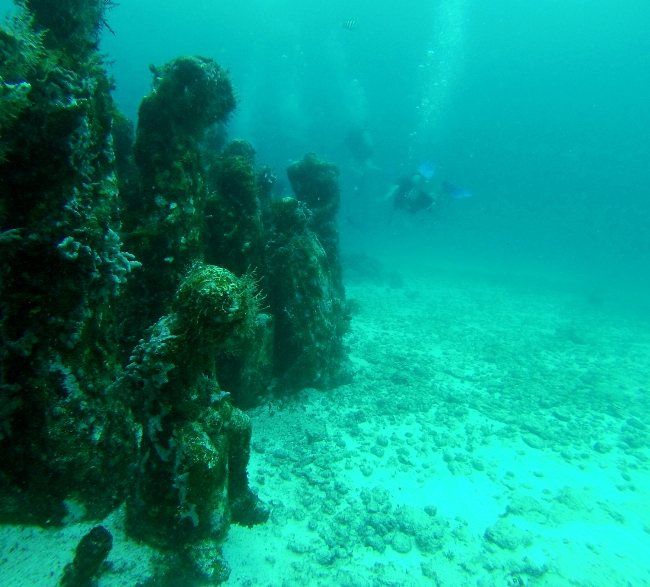Child sculpture underwater museum Cancun Mexico Double-Barrelled Travel