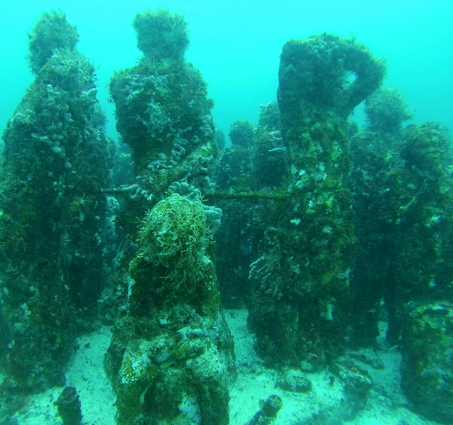 Child sculpture sitting underwater museum Cancun Mexico Double-Barrelled Travel