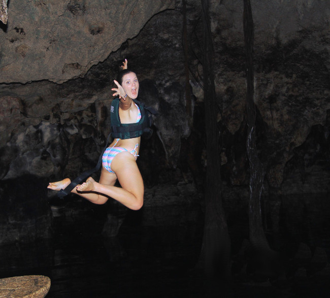 Jumping into cenote Xenotes Oasis Maya Double-Barrelled Travel