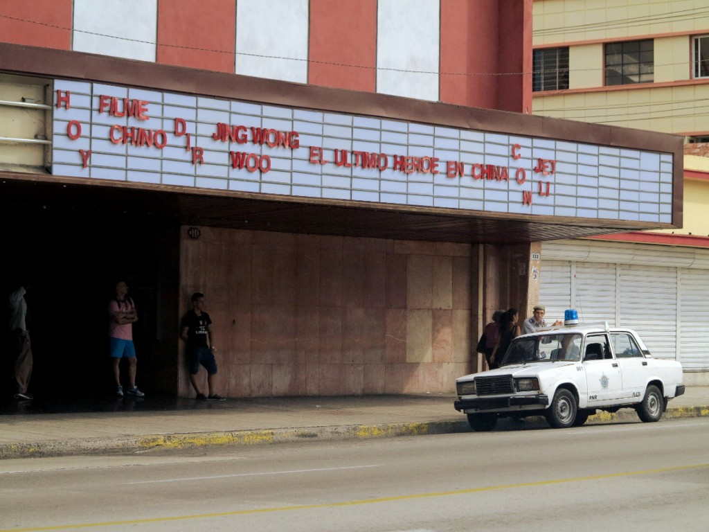 Policeman outside old cinema Cuba Double-Barrelled Travel