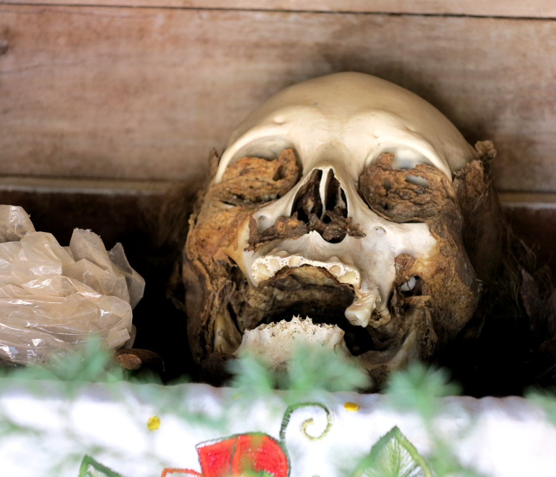 Pomuch cemetery skull with skin 2 Mexico Day of the Dead - Double-Barrelled Travel