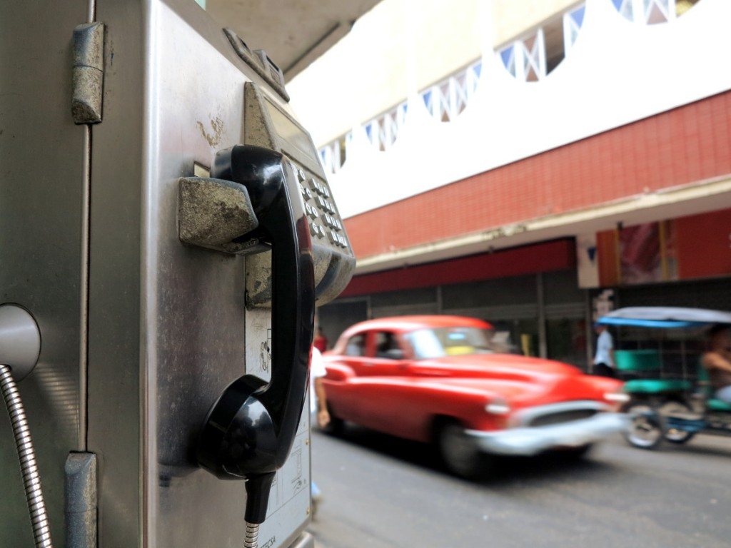 Vintage car and phone Cuba Double-Barrelled Travel
