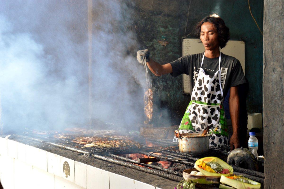 Fish cook Jimbaran fish market Bali Double-Barrelled Travel