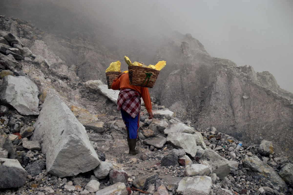 Miner climbs Ijen Volcano Java Double-Barrelled Travel