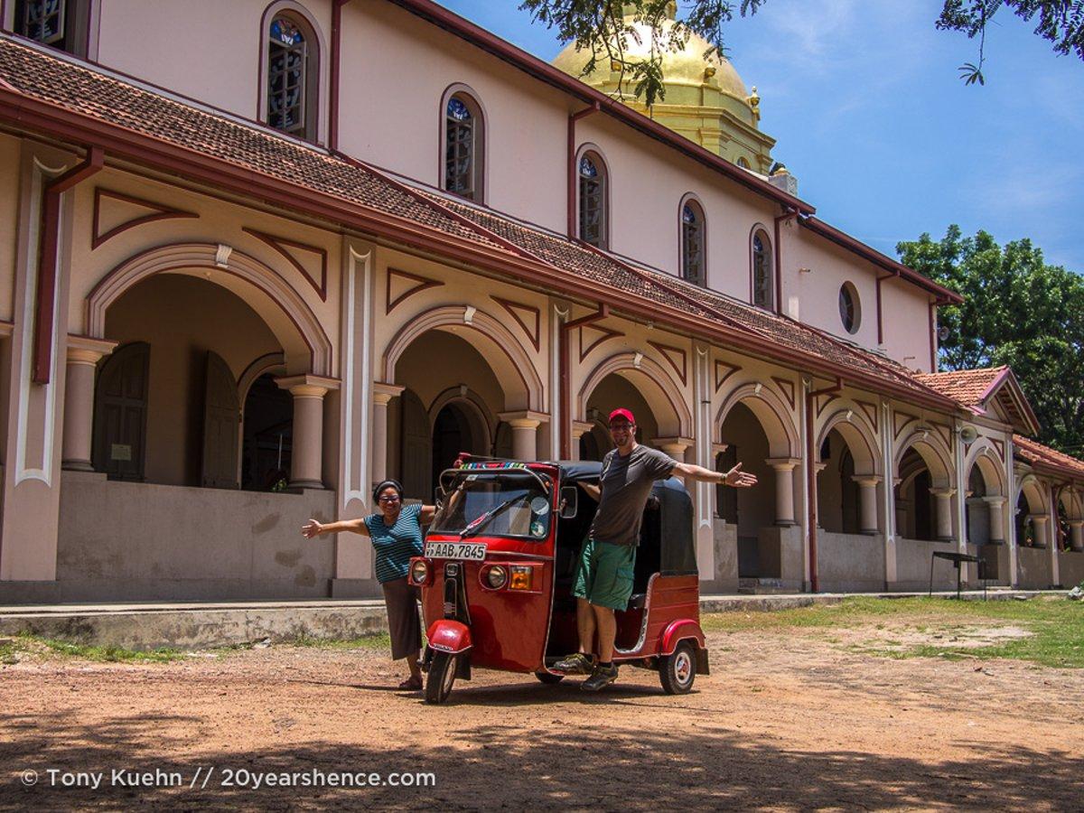 Stephenie driving tuktuk through Sri Lanka