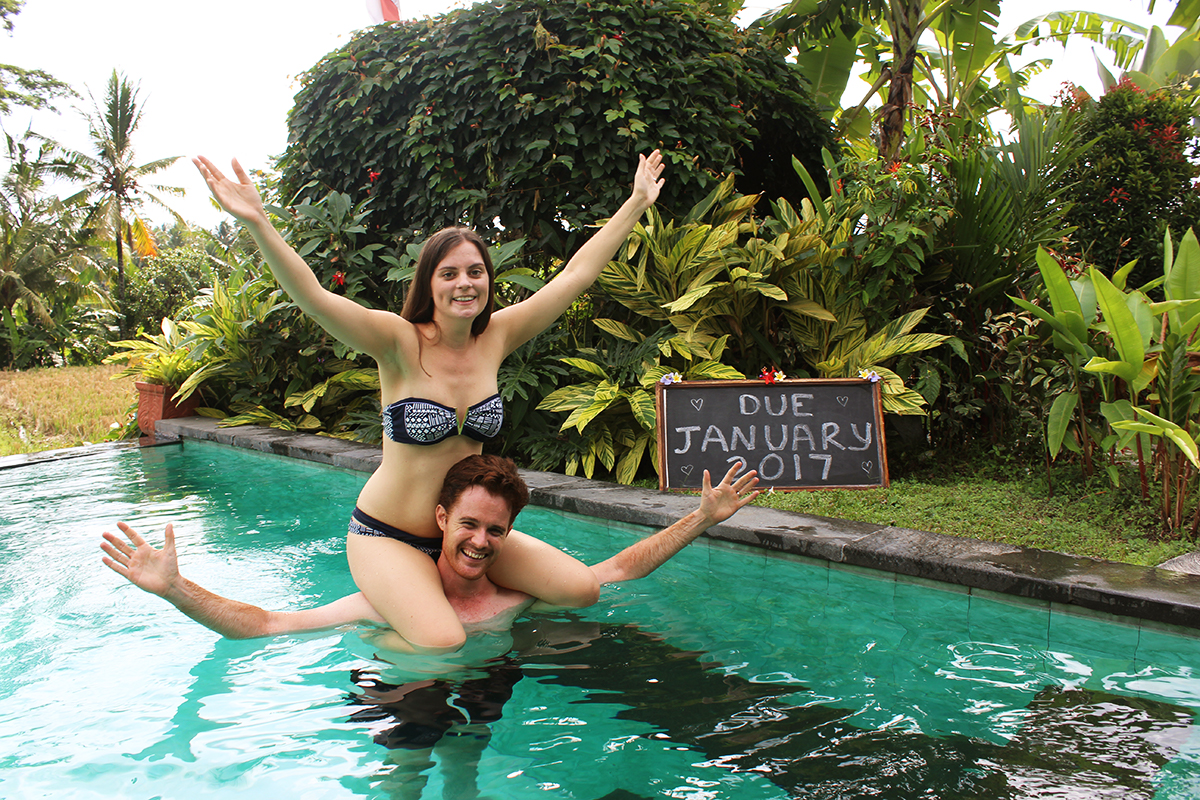 Double-Barrelled Travel baby announcement having a baby