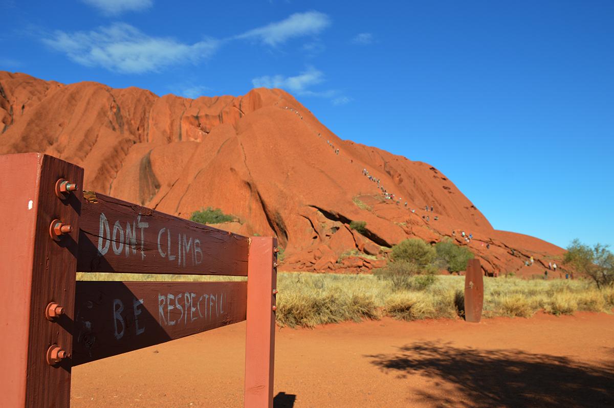 Climbers at Uluru Double-Barrelled Travel
