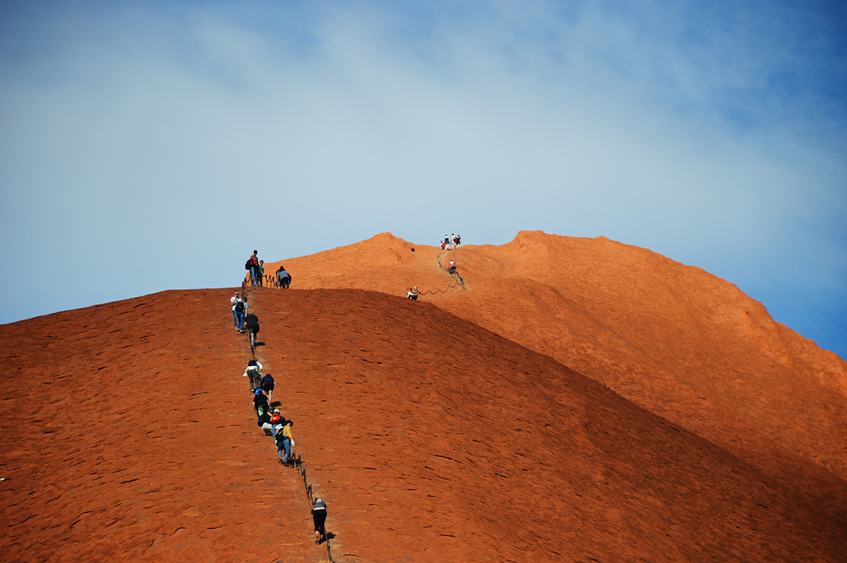 The masses climbing Uluru