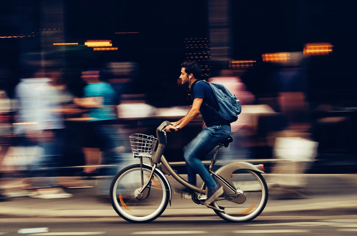 long-distance relocation man on bike