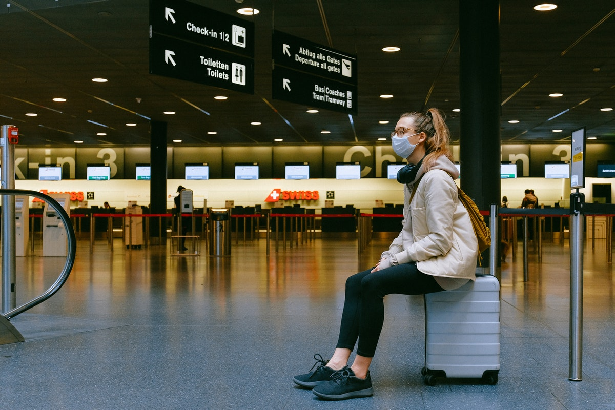 traveller wearing mask in airport