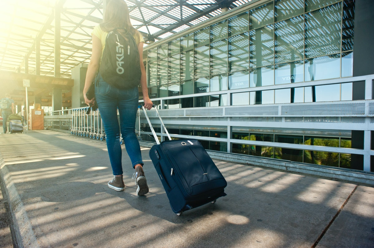 Woman pulling a suitcase behind her