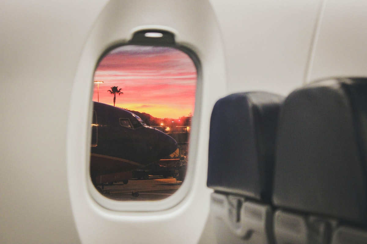 Sunset view out of a plane window